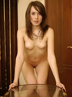 Petite Eleonora is happy to be naked on front of the camra