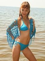 Cute redhead teen poses in tiny bikini