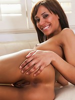 Nubiles.net Courtney Page - Horny hot babe gently strokes her two holes with a transparent dildo on the couch
